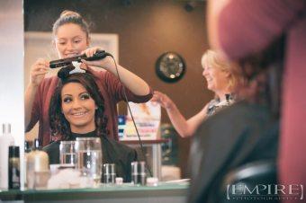 bride getting ready at hair salon