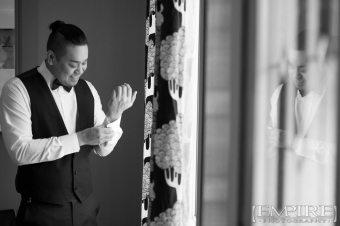 groom getting ready by window