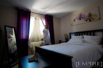 bride in bedroom with dress