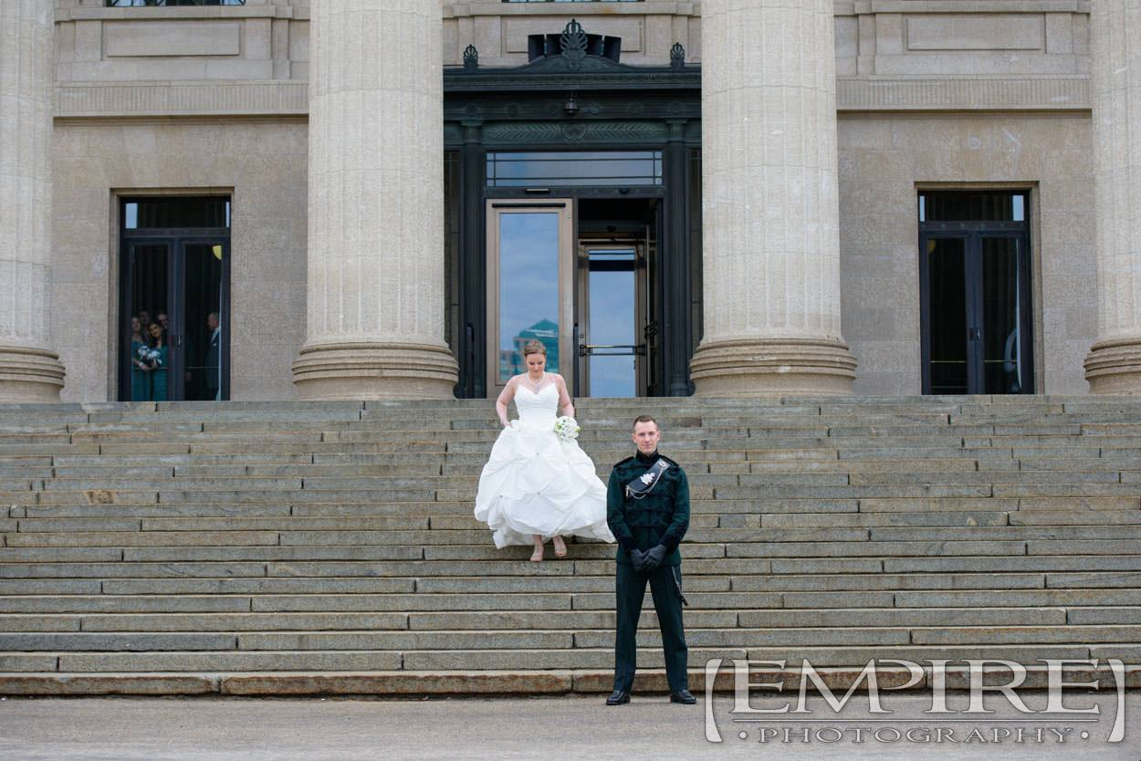 steph and joels reveal at the legislative building stairs